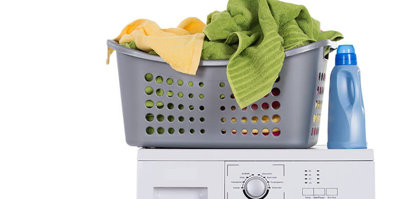 Basket Of Laundry On Top Of Tumble Dryer