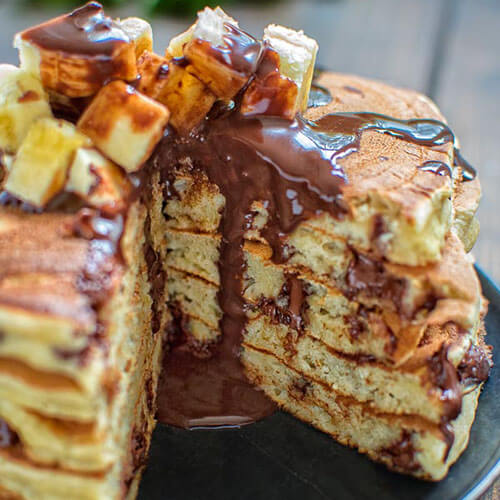 Stacked Pancakes With Dark Chocolate And Banana