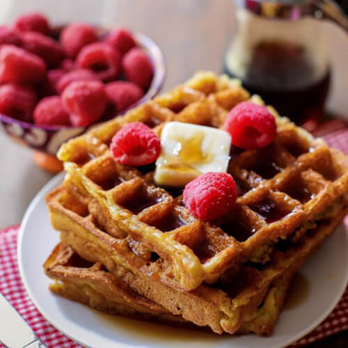 Buttermilk Waffles On Plate Topped With Raspberries