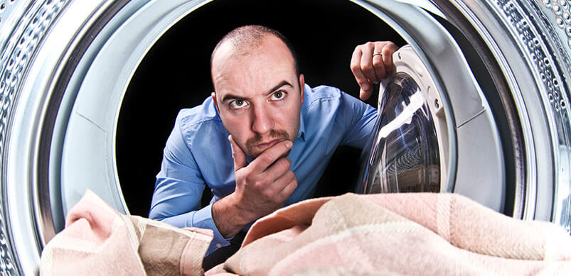 Confused Man Looking Inside Washing Machine