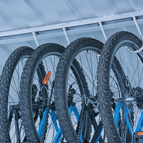 Bicycles Hanging On Ceiling Rack