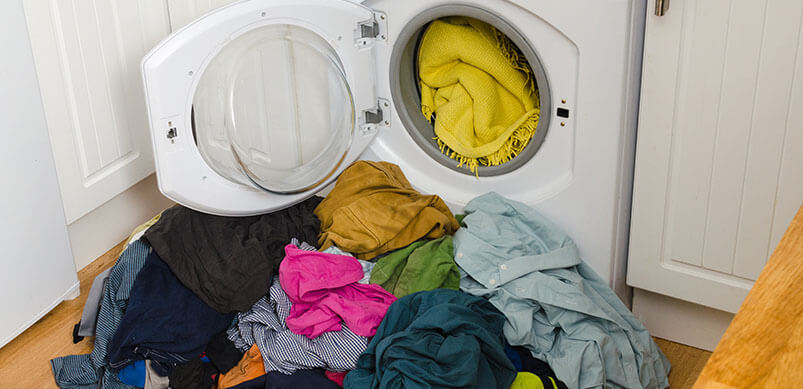 Washing Machine Door Open With Clothes Coming Out