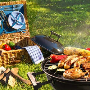 Barbecue With Food Next to Picnic basket
