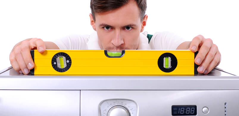 Man Measuring Washing Machine Level