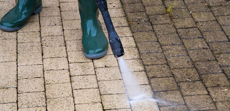 Pressure Washer Cleaning Pavement