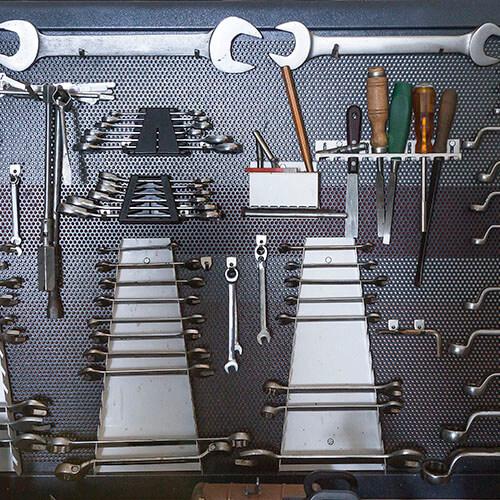 Work Tools Hanging On Pin Board