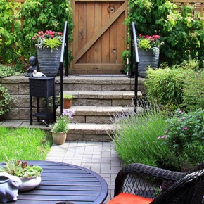 Small Garden With Colourful Plants and Furniture