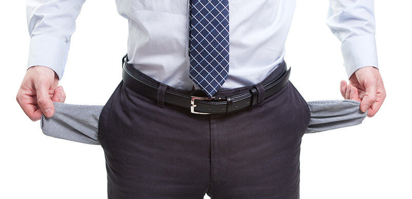 Man Pulling Pockets From Trousers