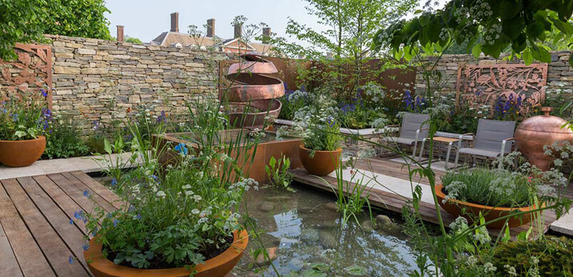 Water Feature Surrounded By Potted Plants