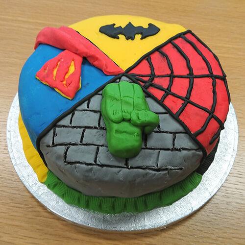 Cake With Superhero Theme On Each Corner