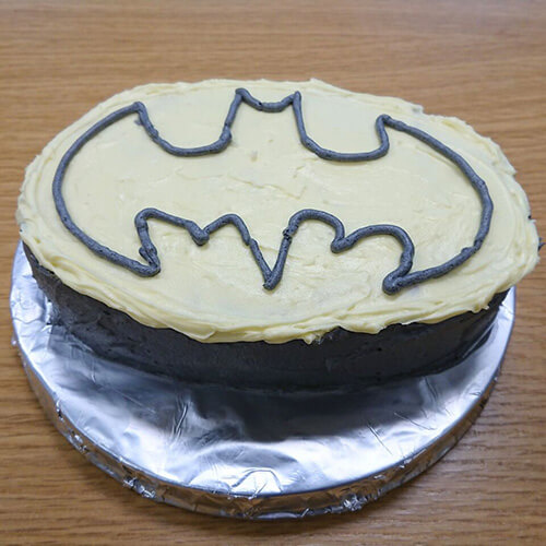 Chocolate Cakw With Batman Logo On Icing
