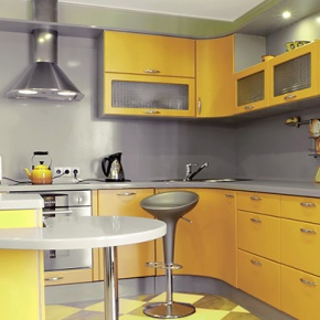 Kitchen With Yellow Shelves and Cupboards