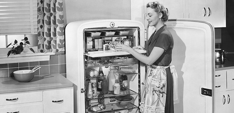 Black And White Image Of Woman And Vintage Fridge
