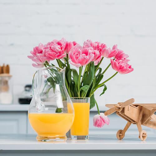 Pink Flowers On Kitchen Shelf