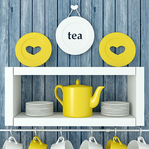 White and Yellow Cups And Plates On Shelves