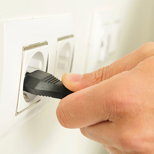 Hand Unplugging Electrical Device
