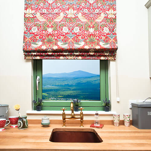 Red Patterned Blind In Kitchen Window