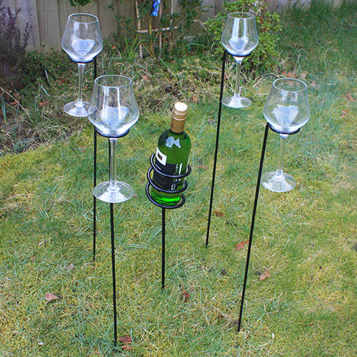 Wine And Glasses Holder Stuck In Grass