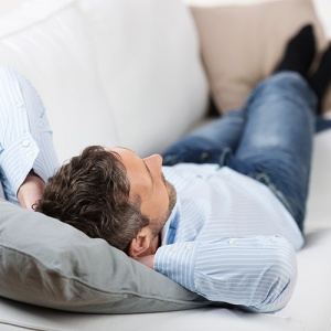 Man Sleeping On Sofa