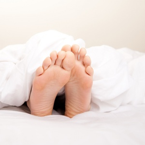 Feet Sticking Out Of Bed