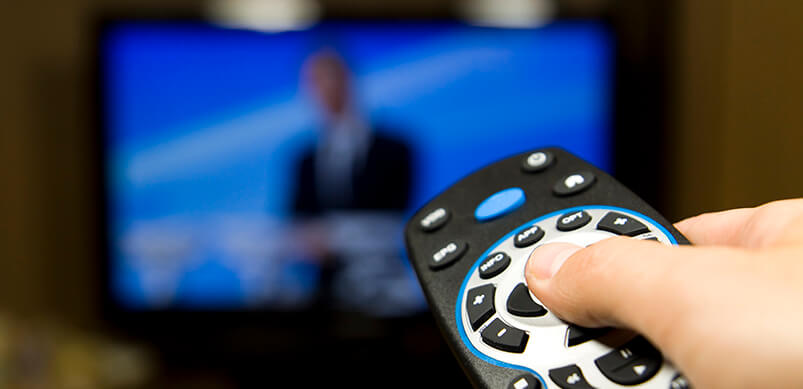 Hand Holding Remote Control To TV