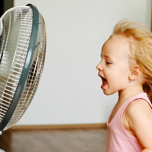 Girl Standing In Front Of Blowing Fan