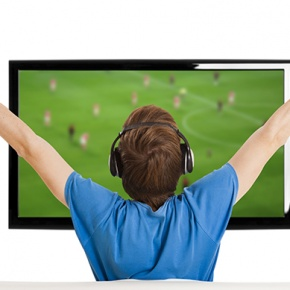 Man Watching football On TV With Arms Up