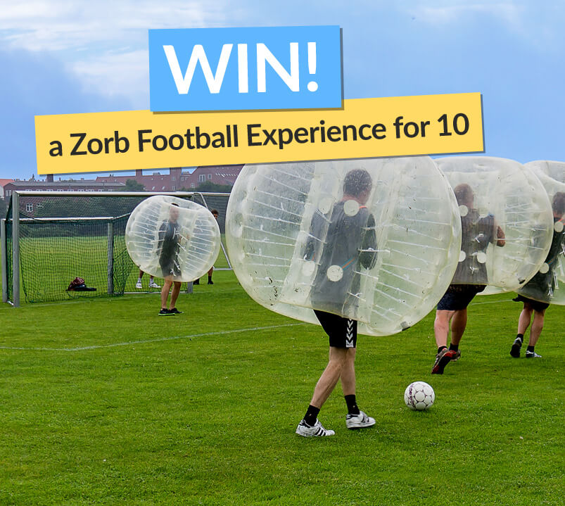 Image of People Playing Zorb Football With Win Sign
