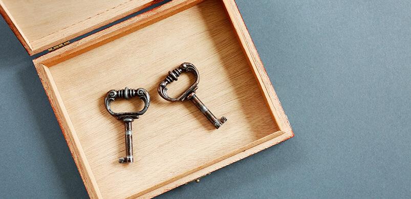 Two Keys In A Wooden Box
