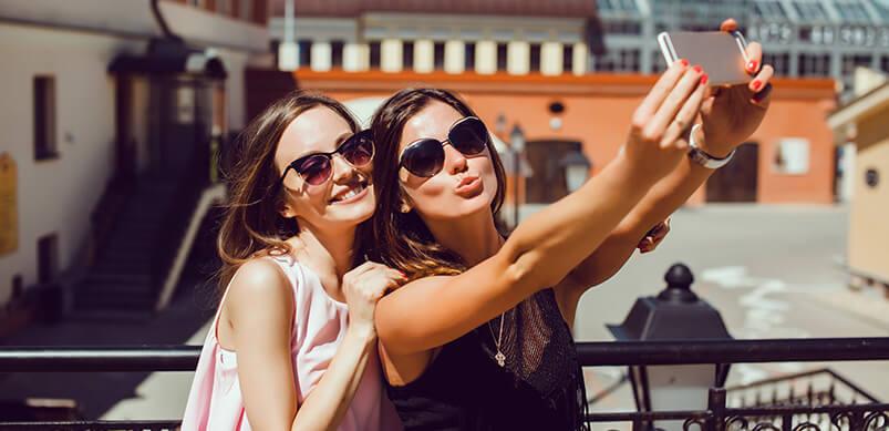 Two Girls Taking A Selfie In The Sun
