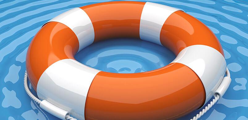 Orange Life Buoy In Water