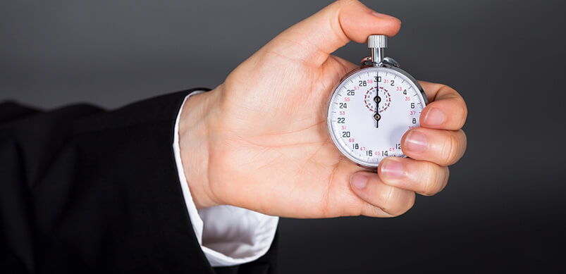 Man Holding Stop Watch In Hand
