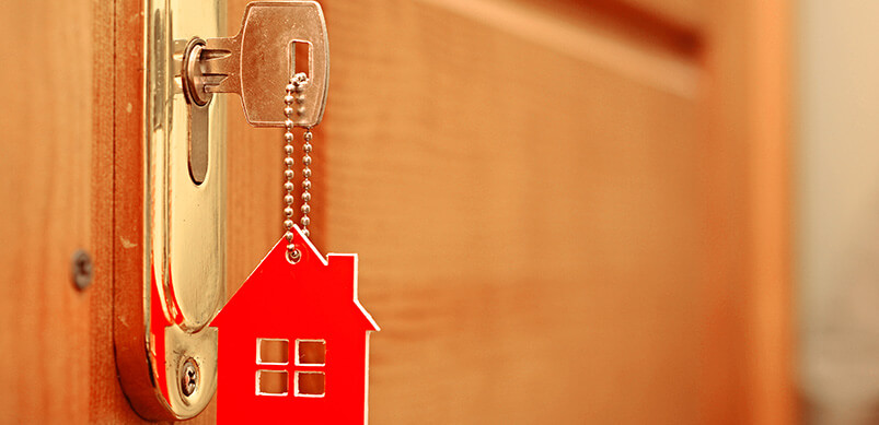 Key In Door With Red House Keyring