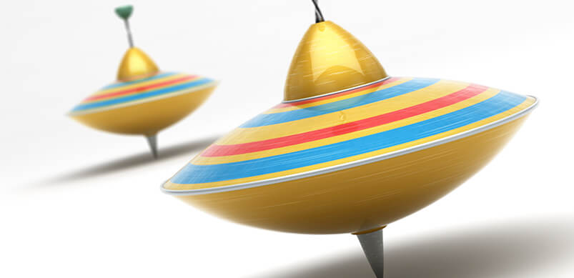 Two Colourful Spinning Toppers