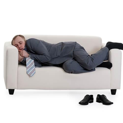 Man Sleeping On A Sofa
