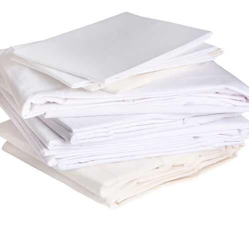 Pile Of White Cotton Bed Sheets