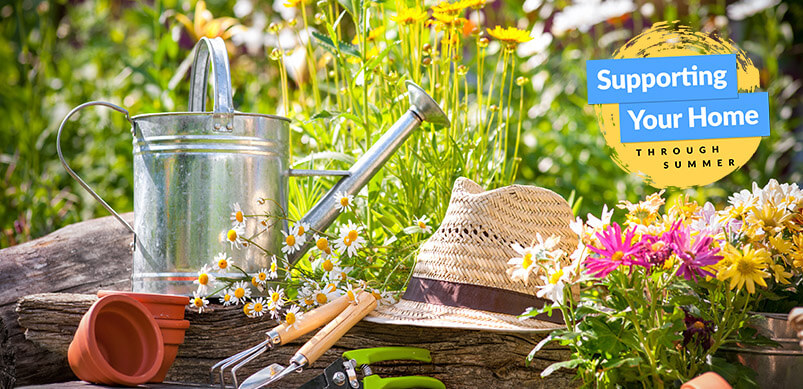 Gardening Tools And Straw Hat In Garden