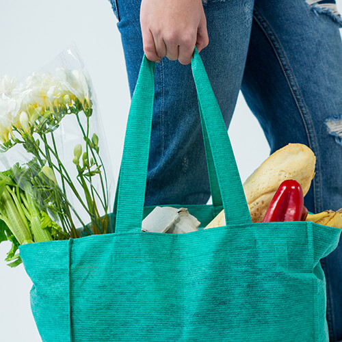 Woman Carrying Shopping In Reusable Bag
