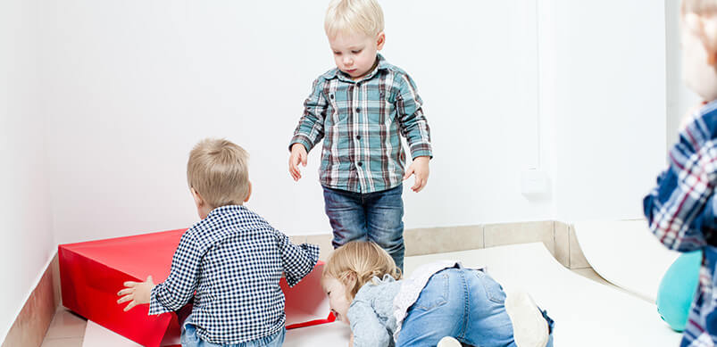 Group Of Children Playing With Open Bag