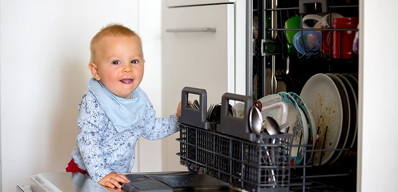 Child Standing By Open Dishwasher