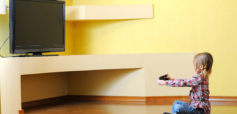 Child Sitting In Front Of TV