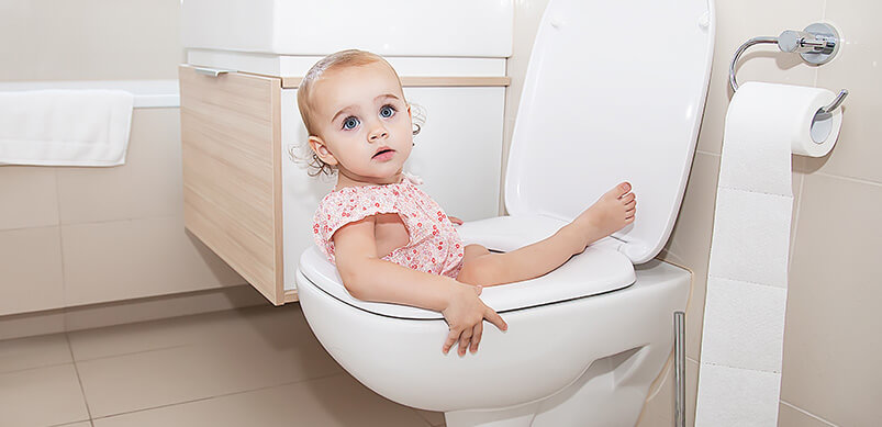 Young Girl Lying Cross Toilet Seat
