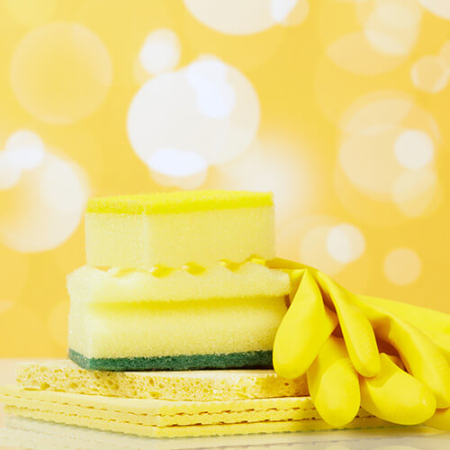 Kitchen Sponge On Yellow Background