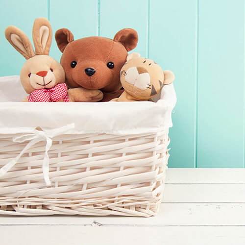 Stuffed Animal Toys In White Basket