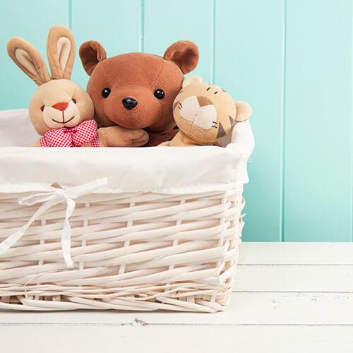 Stuffed Animal Toys In White Basket
