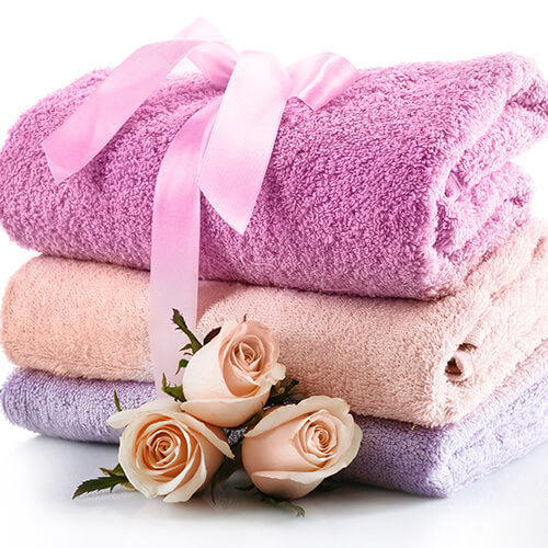 Stack Of Colourful Towels With Flowers