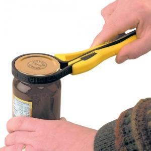 Hands Opening Jar With Opener