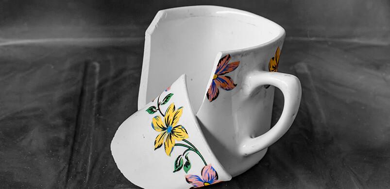 Single Broken White Cup