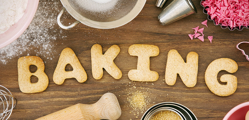 Dough Forming The Word Cookies With Baking Accessories