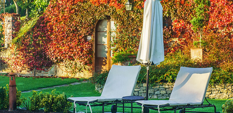 Outdoor Furniture Outside Home With Autumn Leaves
